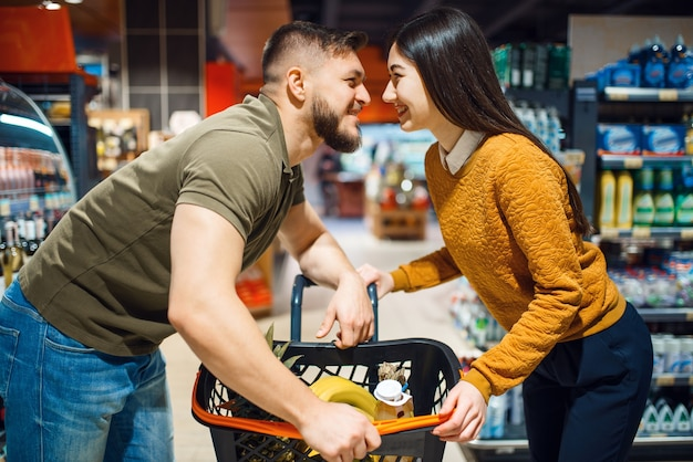 Love couple poses in grocery store