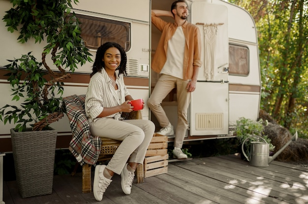Love couple relaxing in rv, adventure on wheels, camping in a trailer. man and woman travels on van, vacations on motorhome, campers leisures in camping-car