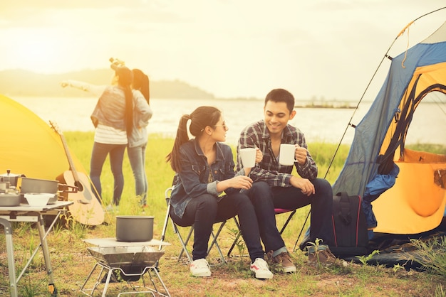 Love couple travel and camping at natural park. recreation and journey outdoor activity. tourist tent in the forest.