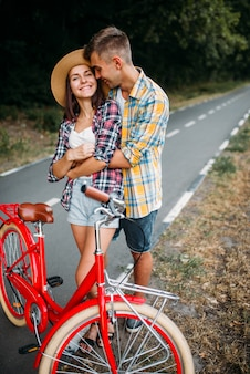 Love couple walk on vintage bikes romantic journey
