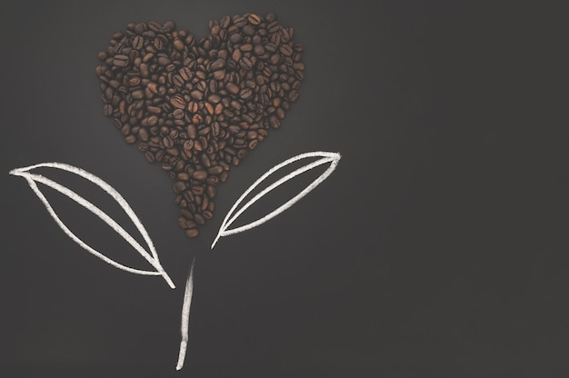 Love drinking coffee coffee beans arranged in a heart shape