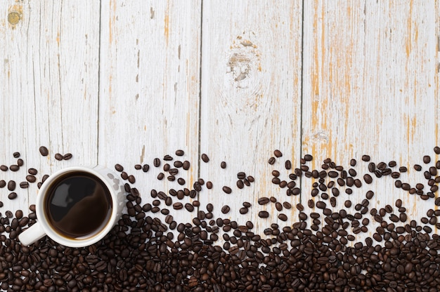 Love drinking coffee, coffee mugs and coffee beans on the table