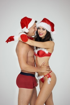 Love embracing of sexy couple