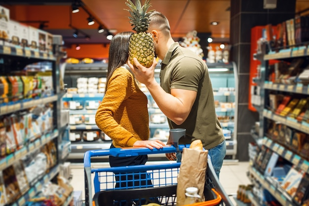Love family couple kissing in grocery store