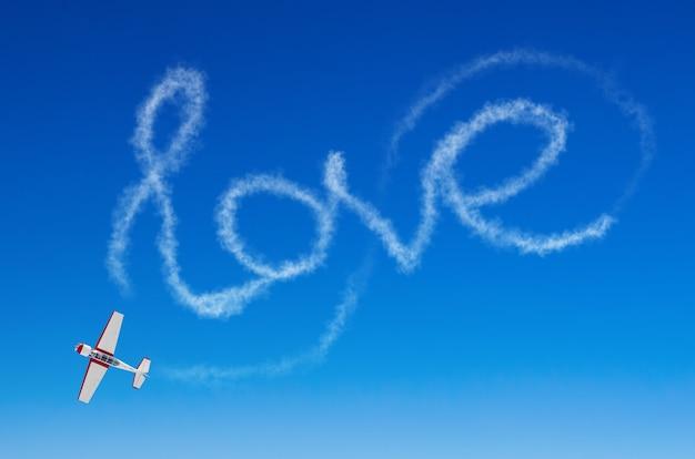Love figurative inscription from a white smoke trail airplane.