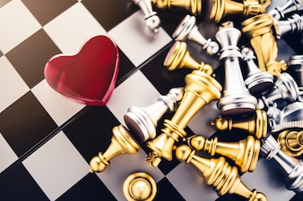 Love games strategy concept with red heart with chess board game