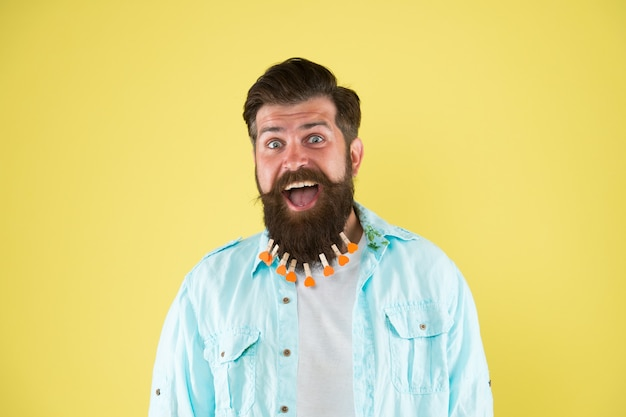 Love grooming. love myself. nourish hair with love. valentines day. barbershop concept. hairdresser salon. hairstyle guideline. man lot clothespin on beard. brutal hipster with clothespins hearts.