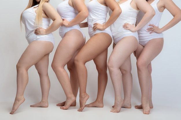 In love and harmony with myself. close up of plus size young women posing on white