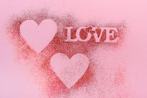 Love inscription from glitter powder on table