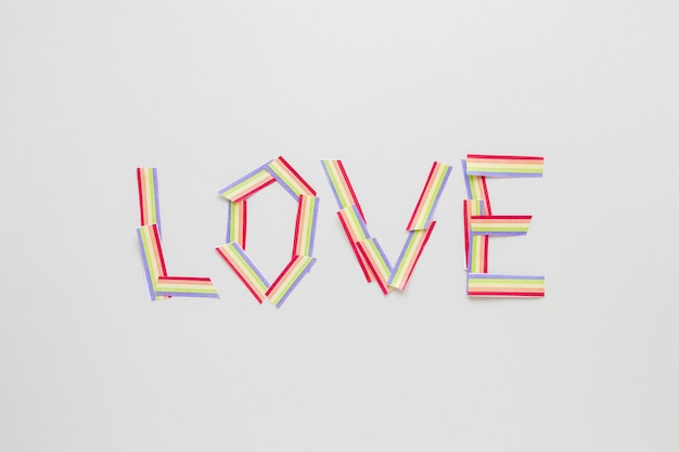 Love inscription made of small paper rainbows