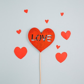 Love inscription on paper heart on wooden stick