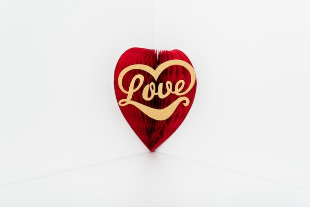 Love inscription on red paper heart