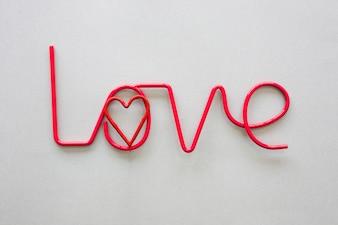 Love inscription with heart on table