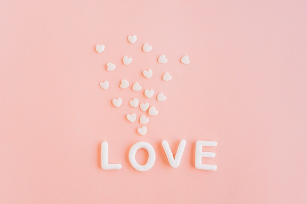 Love inscription with small hearts