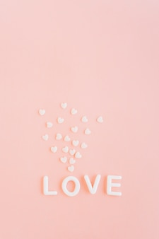 Love inscription with white hearts