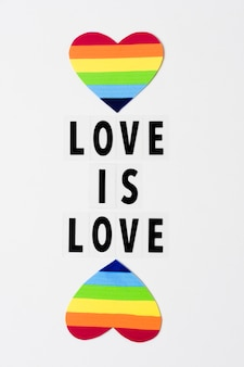 Love is love concept with hearts in rainbow colors