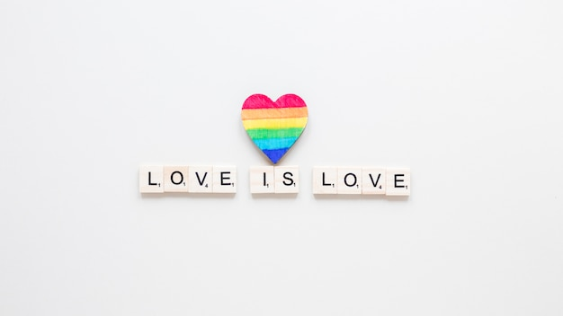 Love is love inscription with rainbow heart