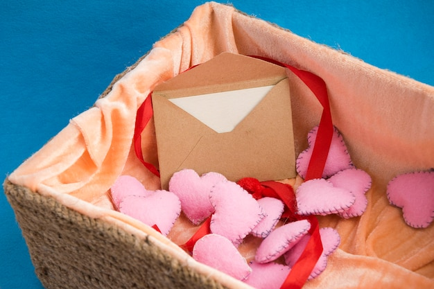 Love letter in box full of plush pink hearts.