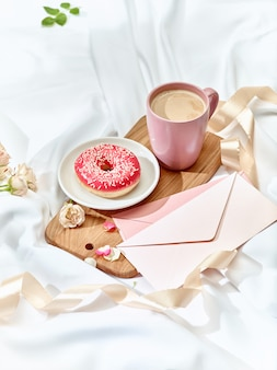 Love letter on table with breakfast