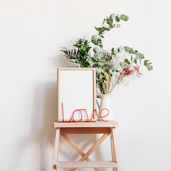 Love letters and frame on stool