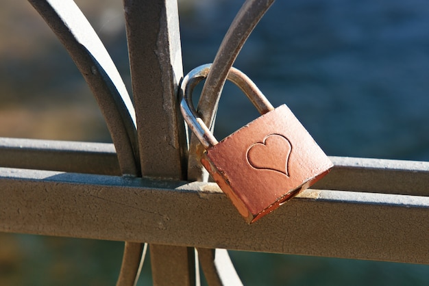 Love lock engraved with a heart