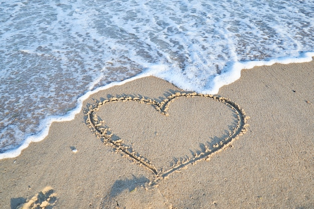 Love message on the beach sand  vacation and travel