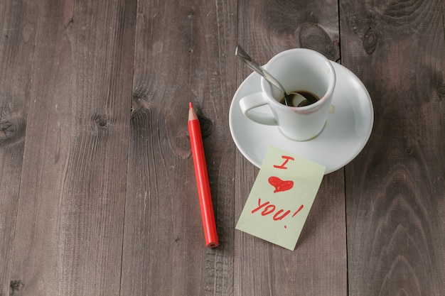 Love message on table with coffee background