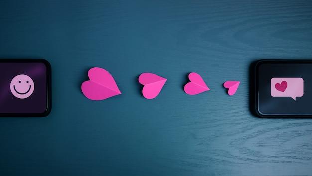 사랑의 메시지. 발렌타인 데이 개념. 모바일을 통해 누군가에게 하트 러브 심볼 보내기