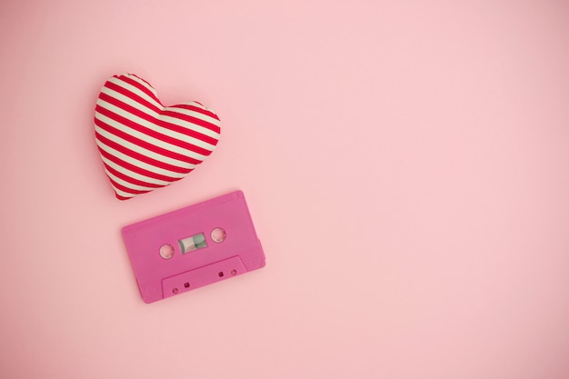 Love music concept. valentines day background with audio tape cassette and a red heart.