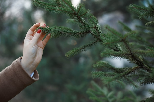 Love nature concept. girl touching a tree. environment eco concept.
