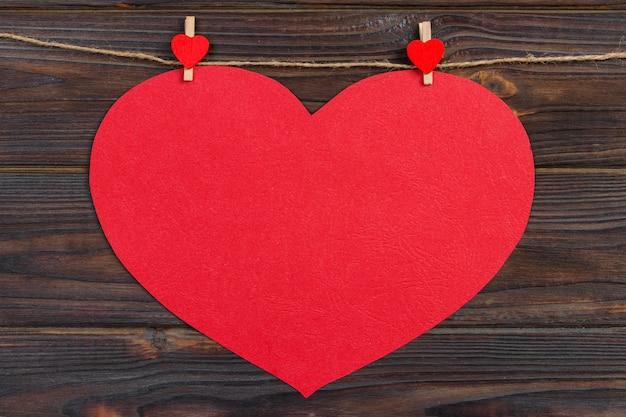 Love paper heart on string.