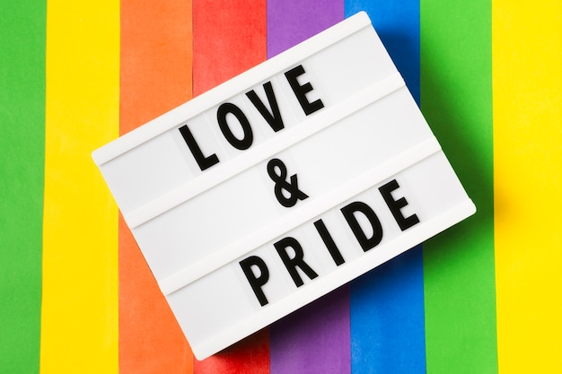 Love and pride concept with rainbow background