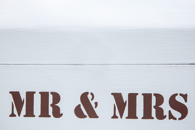 Love and relationship. inscription mr and mrs on white wooden