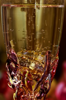 Love rings wedding rings glass of champagne
