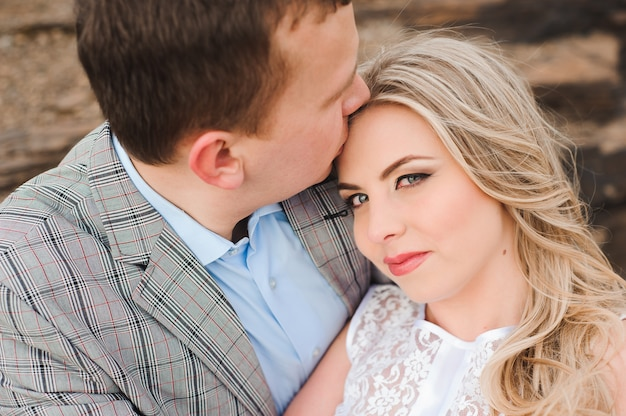Love, romance and people concept - happy young couple hugging