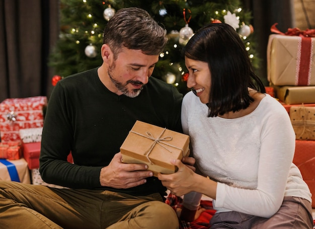 In love senior couple exchanging gifts