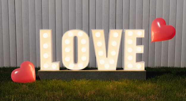 Вывеска love с лампочками в саду