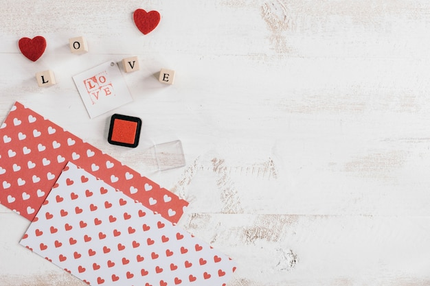 Love stamps with papers and ink