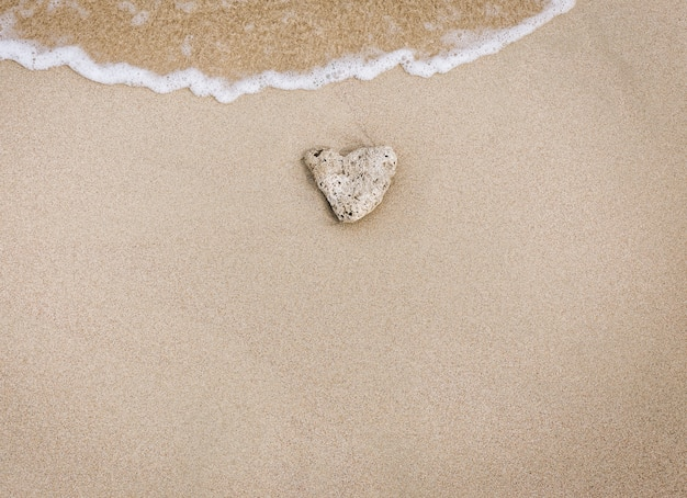 Love stone in the sand