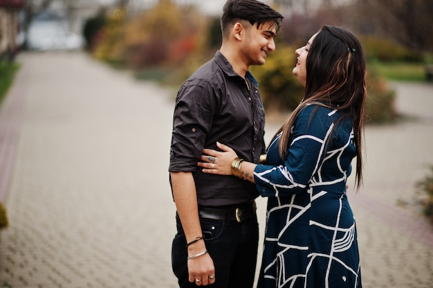 Love story of indian couple posed outdoor