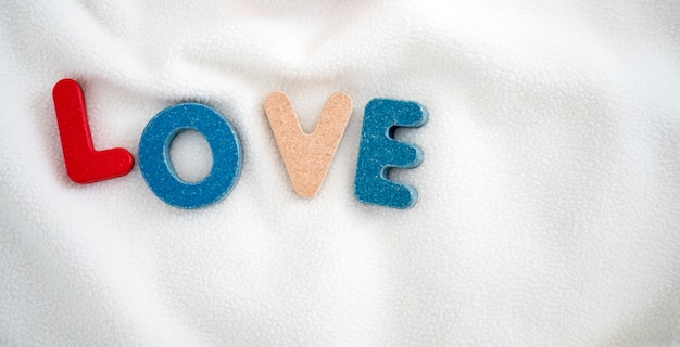 Love text wooden word on blanket and copy space background