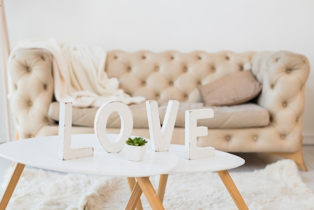 Love title on table in room