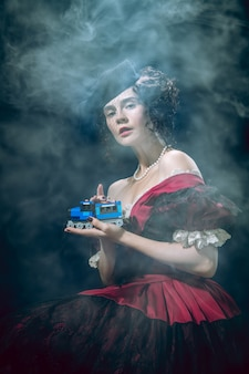 Love tragic. young woman as anna karenina isolated on dark blue