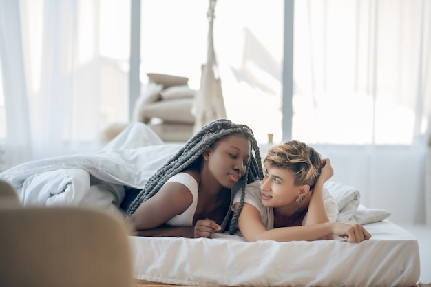 In love. two girls lying on the bed and feeling in love