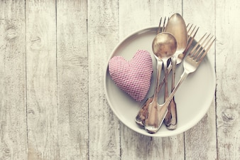 Love, valentine's day or eating concept with vintage cutlery, pl
