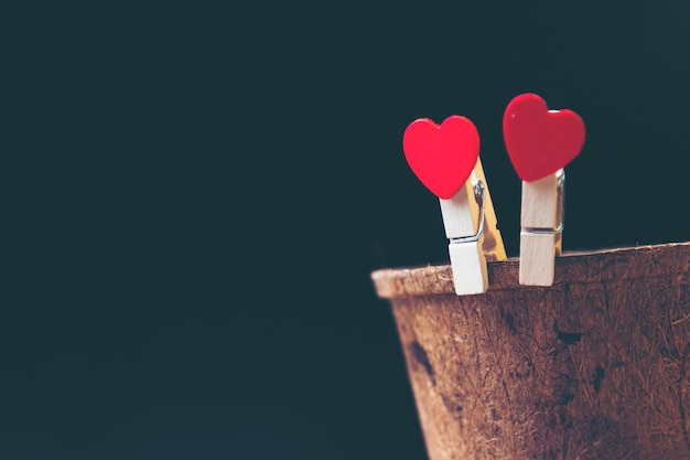 Love for valentine's day - two red hearts hung together