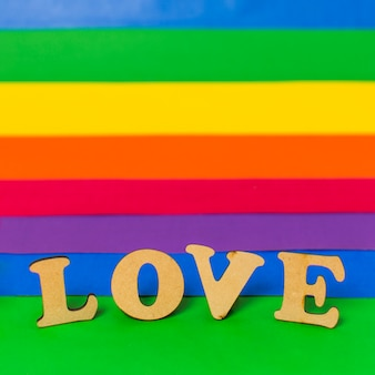 Love wooden word and lgbt flag
