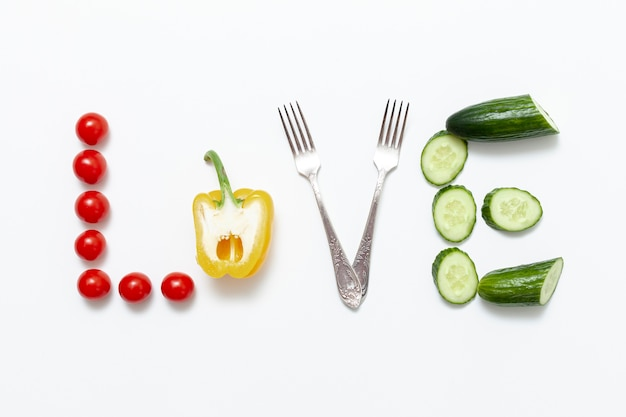Love written artistic with vegetables and forks
