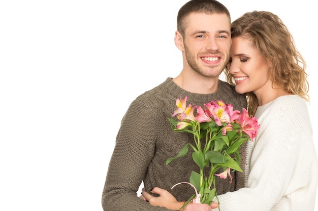 Love you forever. studio portrait of a gorgeous loving couple posing with flower bouquet isolated on white copyspace on the side