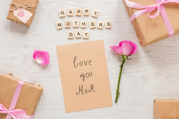 Love you mom inscription with gift box and rose